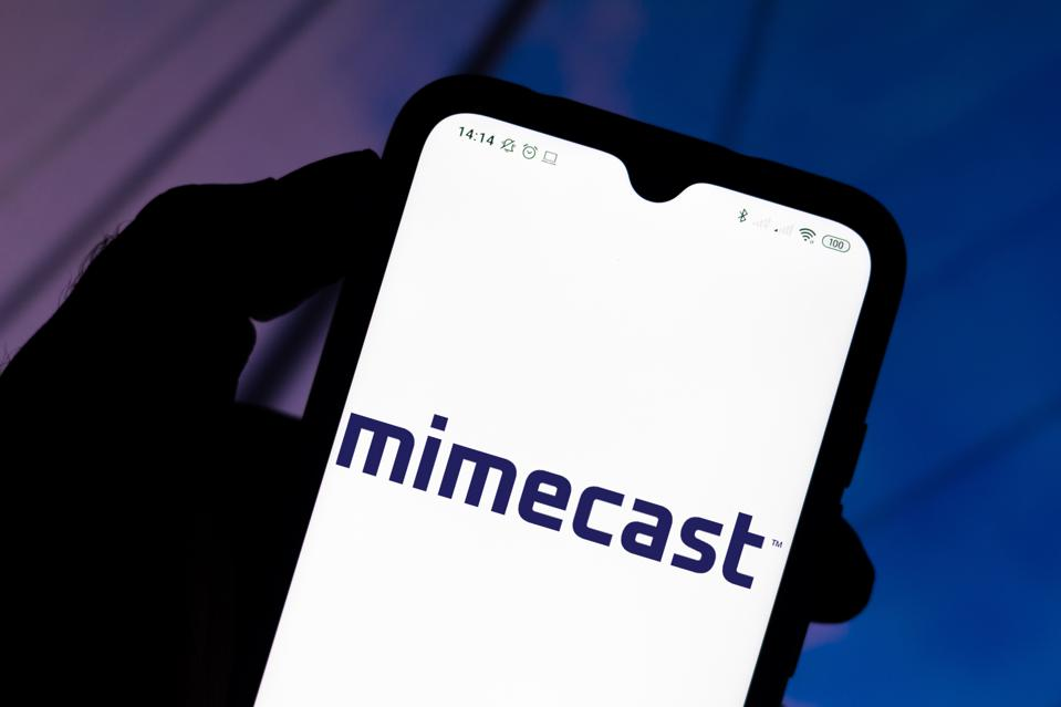 In this photo illustration the Mimecast logo seen displayed...