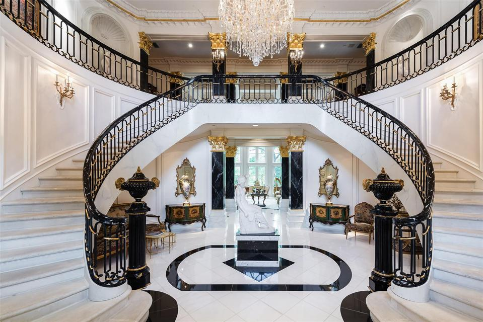 Dramatic foyer with double stairway