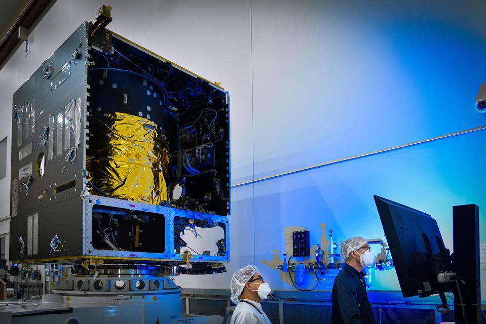 In this photo, taken in November 2020, technicians power on the main body of NASA's Psyche spacecraft — called the Solar Electric Propulsion (SEP) Chassis — for the first time, in a clean room at Maxar Technologies in Palo Alto, California.