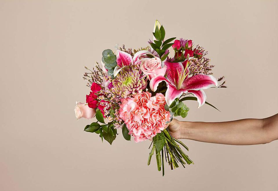 Valentine's Day bouquet of ink hydrangea, lilies, roses, accented by greenery