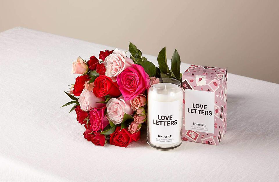 Mixed color roses with a love letters candle