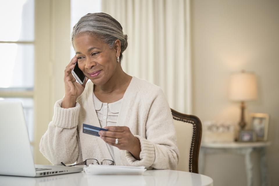 Older African American woman shopping online
