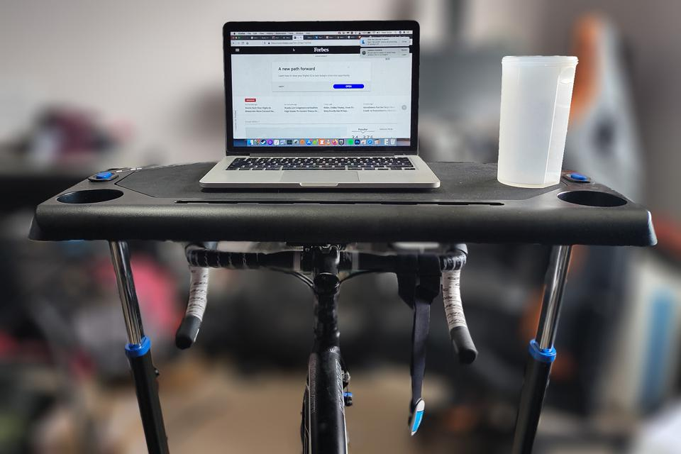 A photo of a MacBook on the Lifeline trainer desk.