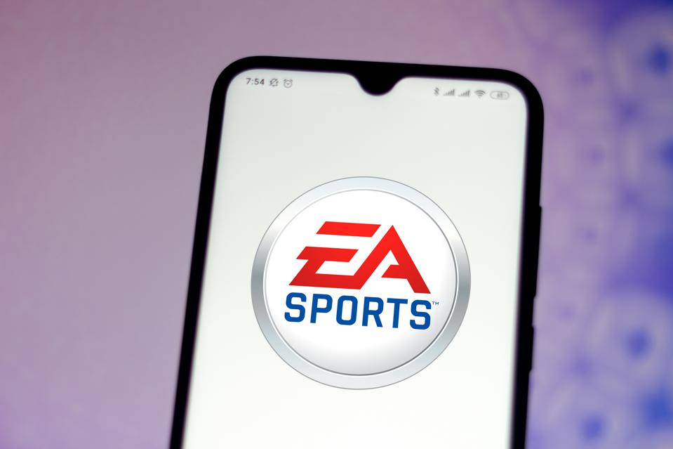 In this photo illustration the EA Sports logo seen displayed...