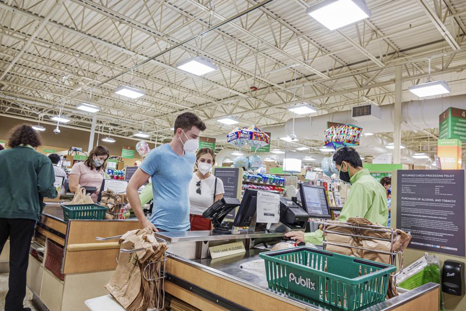 Florida, Orlando, Publix supermarket, customer at check out with cashier all wearing face masks