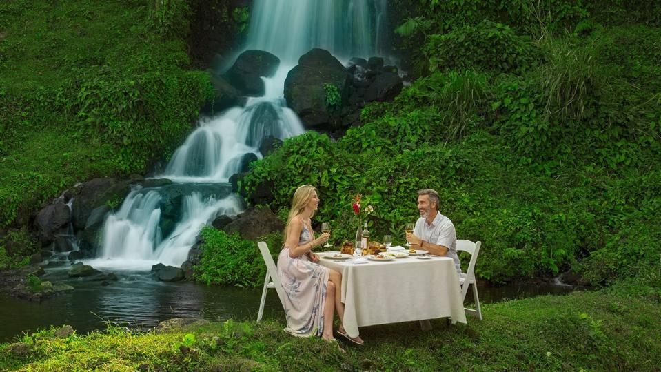 couple eating by waterfall