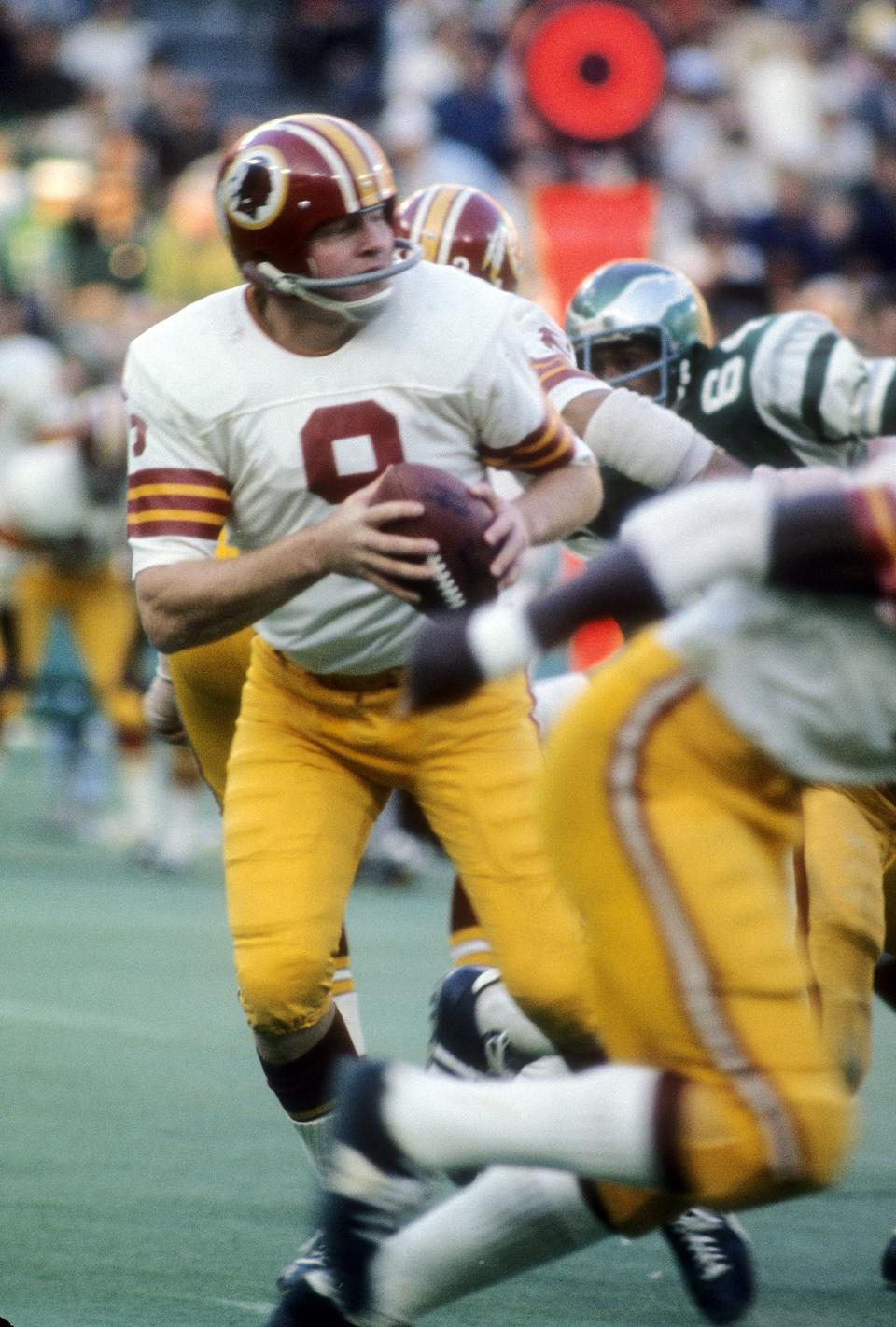 PHILADELPHIA, PA - CIRCA 1971:  Quarterback  Sonny Jurgensen #9 of the Washington Redskins drops back to pass against the Philadelphia Eagles during an NFL football game circa 1971 at Veterans Stadium in Philadelphia, Pennsylvania. Jurgenson played for the Redskins from 1964-74. (Photo by Focus on Sport/Getty Images)
