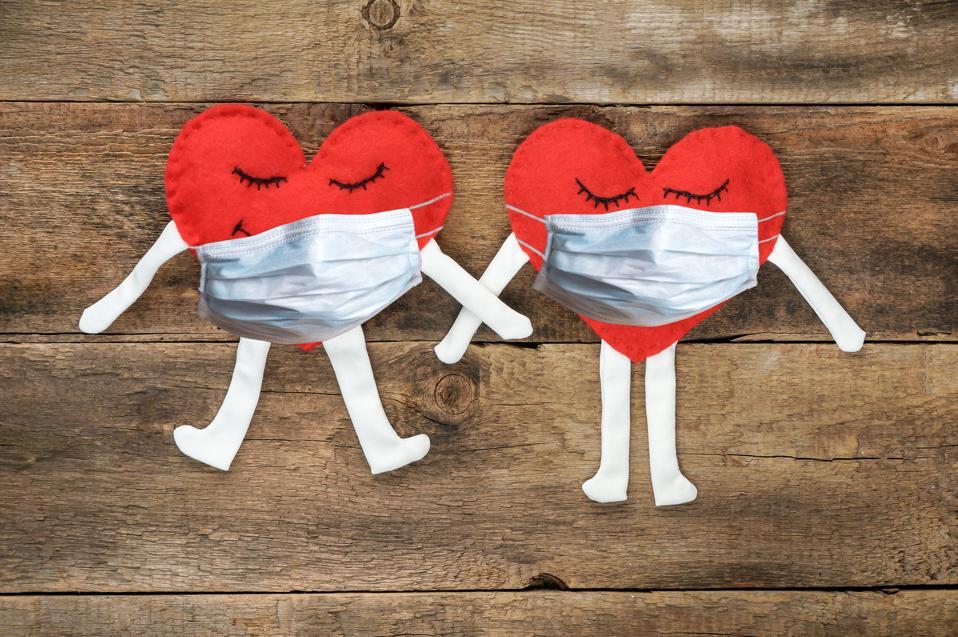 loving couple in medical masks on quarantine