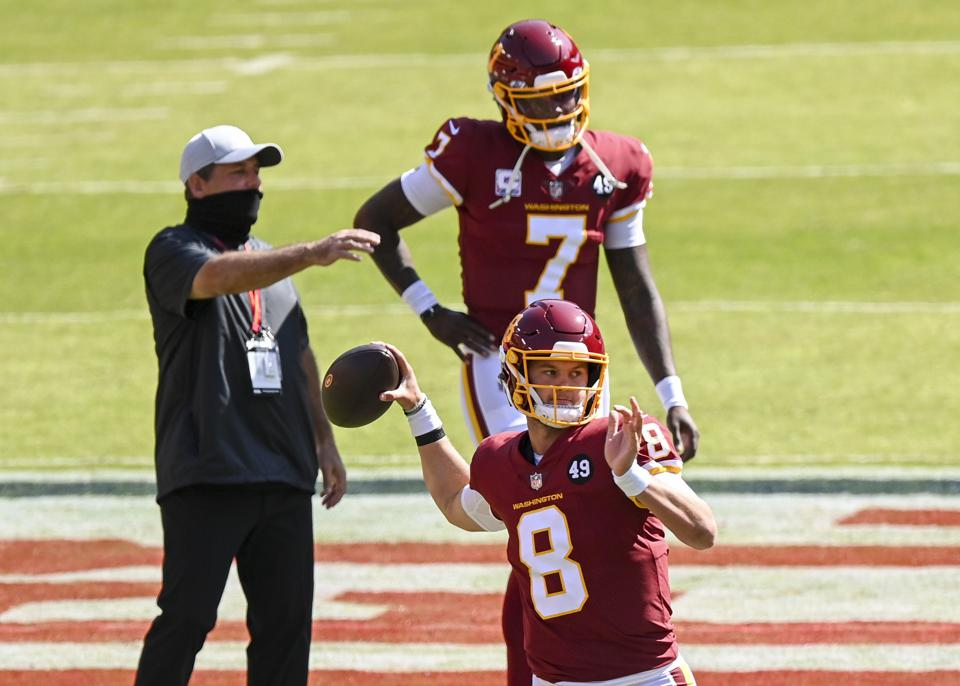 LANDOVER, MD - OCTOBER 4:  Washington Football Team quarterback Kyle Allen (8) loosens up with quarterback Dwayne Haskins (7) prior to action against the Baltimore Ravens at FedEx Field. (Photo by Jonathan Newton /The Washington Post via Getty Images)