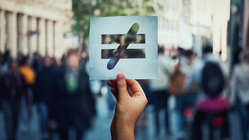 a ″does not equal″ sign held over a crowd of people