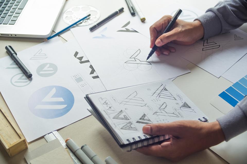 Graphic designer drawing sketch design creative Ideas draft Logo