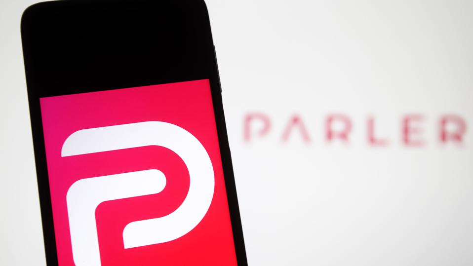In this photo illustration the Parler logo seen displayed on...