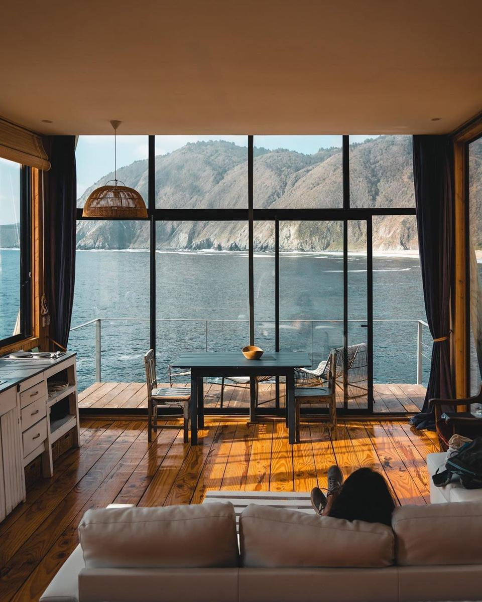 Cabin overlooking water and mountains