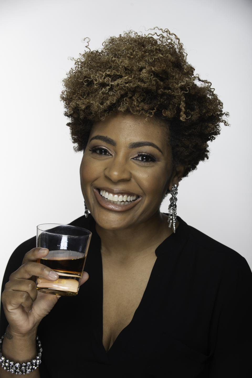 Black Bourbon Society founder Samara Davis with glass of whiskey