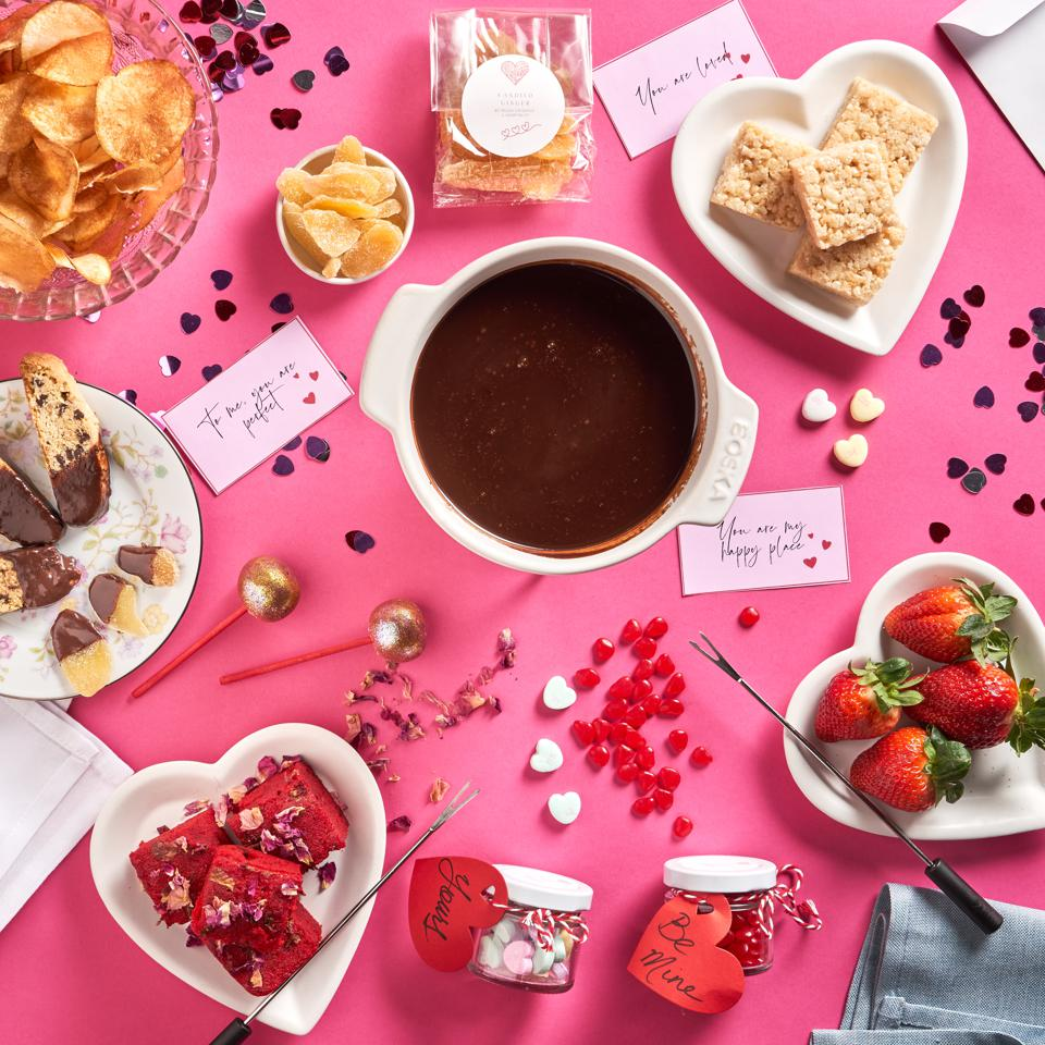 In this photo, is everything you get in the Baldor/Relish Chocolate Fondue Kit including the reusable fondue pot, fondue forks, chocolate sauce, candies, table decor, red velvet cake, biscotti, potato chips, rice crispy treats, crystalized ginger and more.
