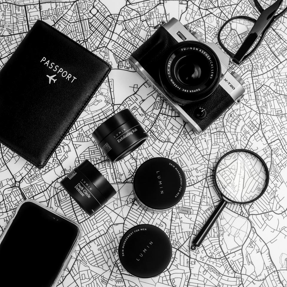 black and white, passport booklet, camera, magnifying glass, smartphone, grooming products