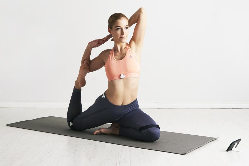 Yoganotch sensors giving real-time feedback to woman in yoga position