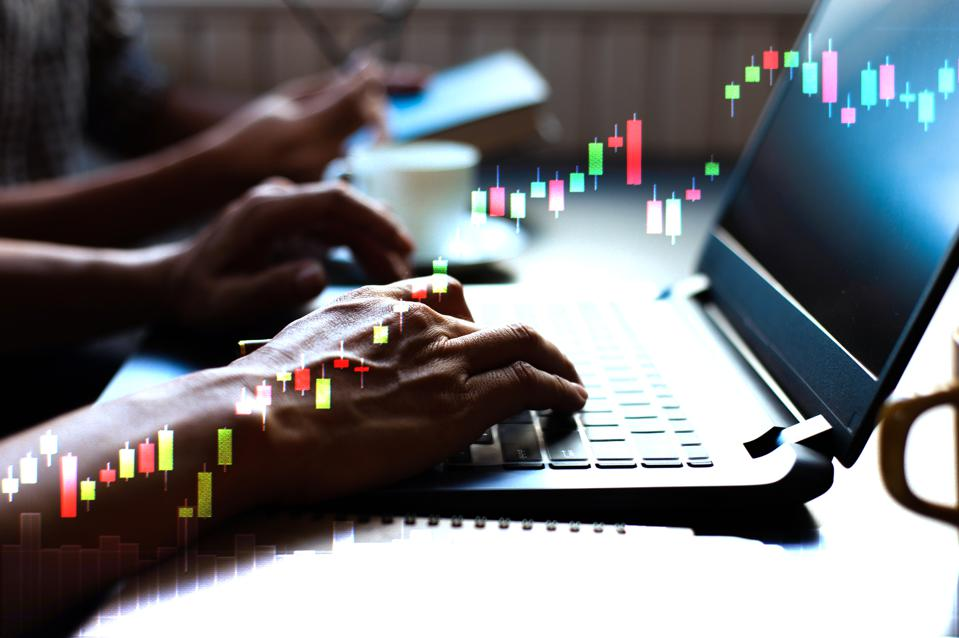 Close-up of online stock traders during an uptrend market.