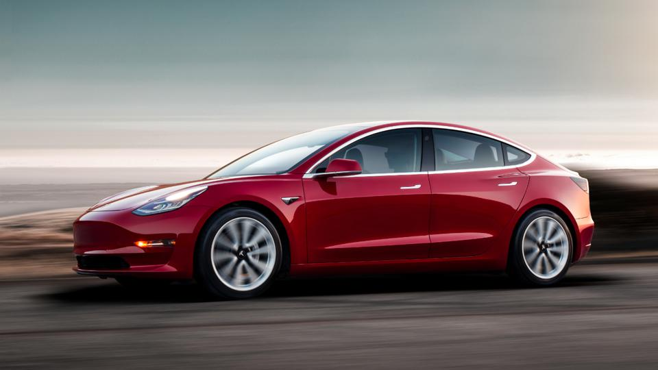 Red Tesla 3 on the road
