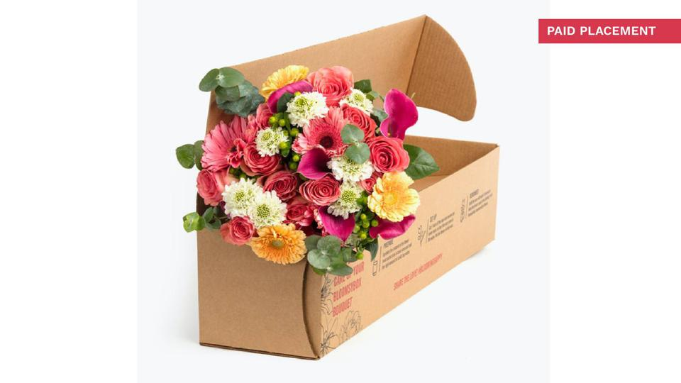 A bouquet of flowers in a box for shipment