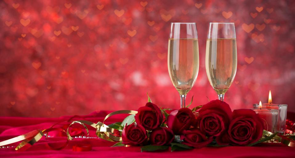 Champagne glass and roses on velvet drape