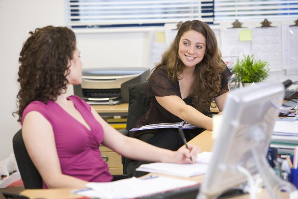 2 working women talking