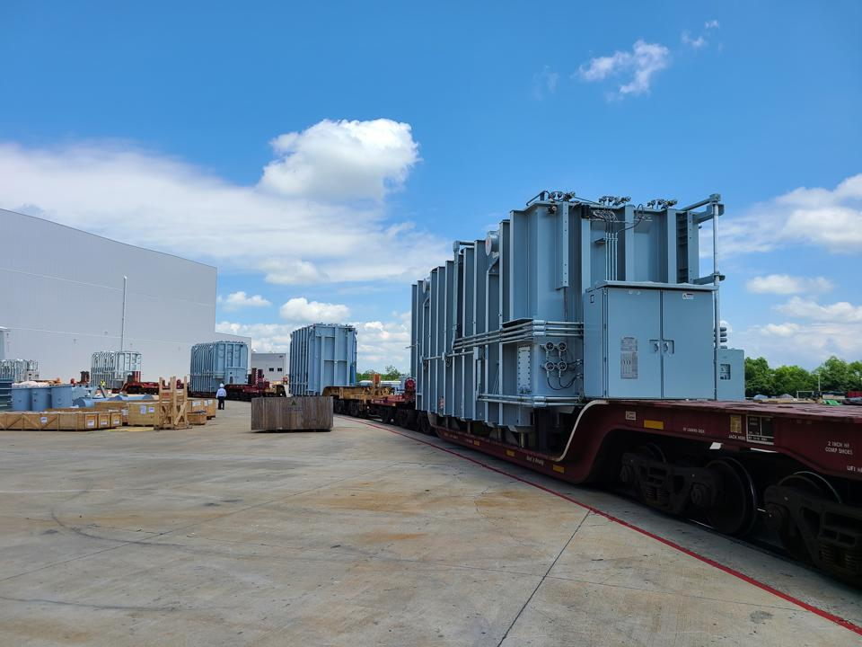 Transformers on a rail car for shipment after their construction at the Hyundai Power Transformers facility in Alabama.