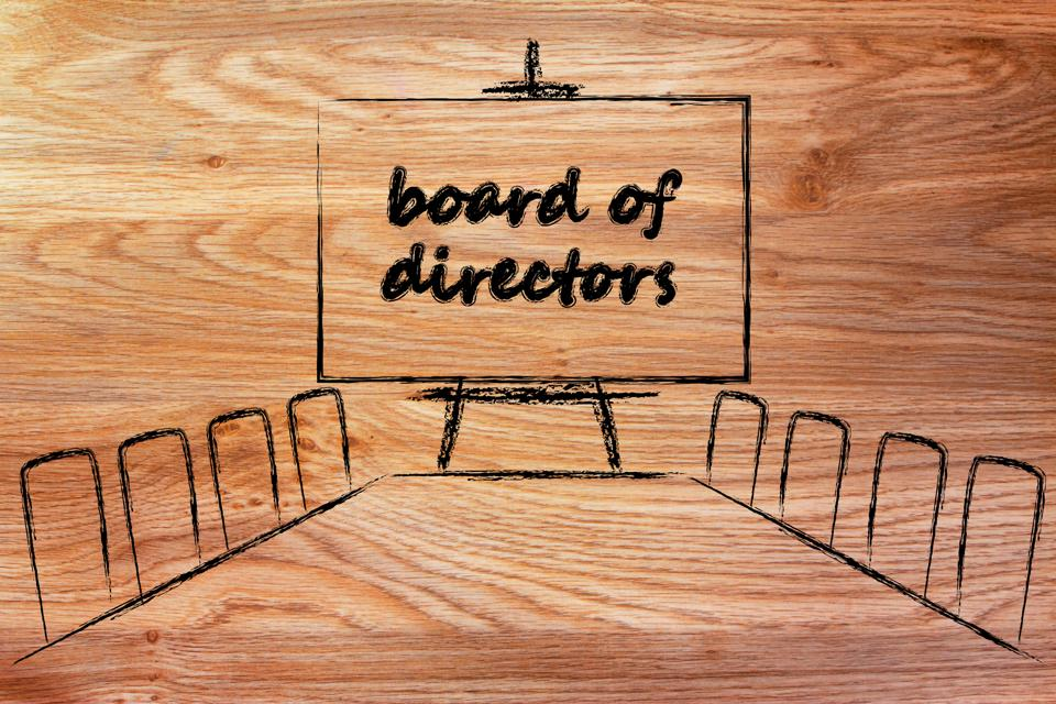 Board of directors sign and chairs etched into a piece of wood.