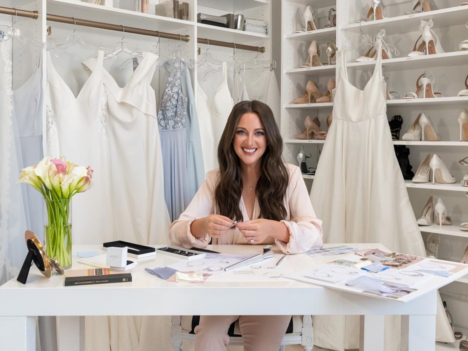 Celebrity stylist Micaela Erlanger works on design for Forevermark in studio filled with wedding dresses.