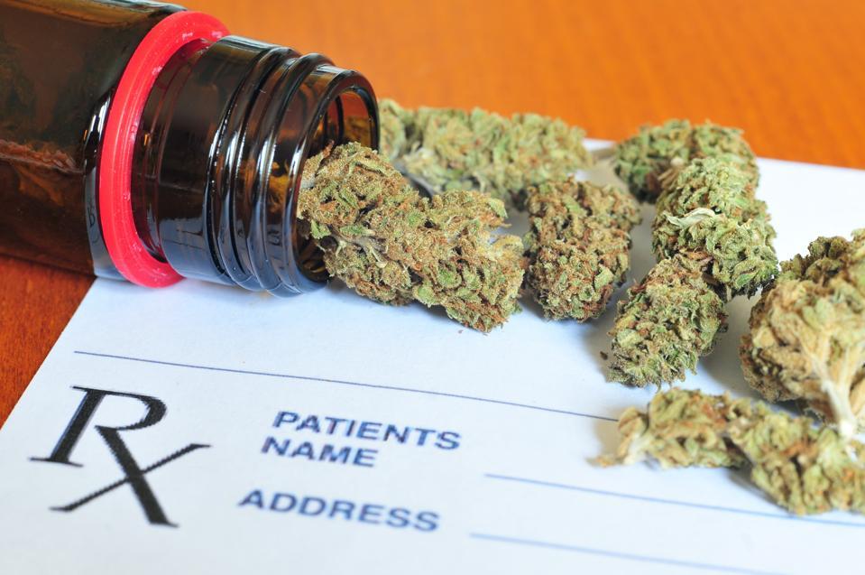 Dry medical marijuana buds and a prescription form.