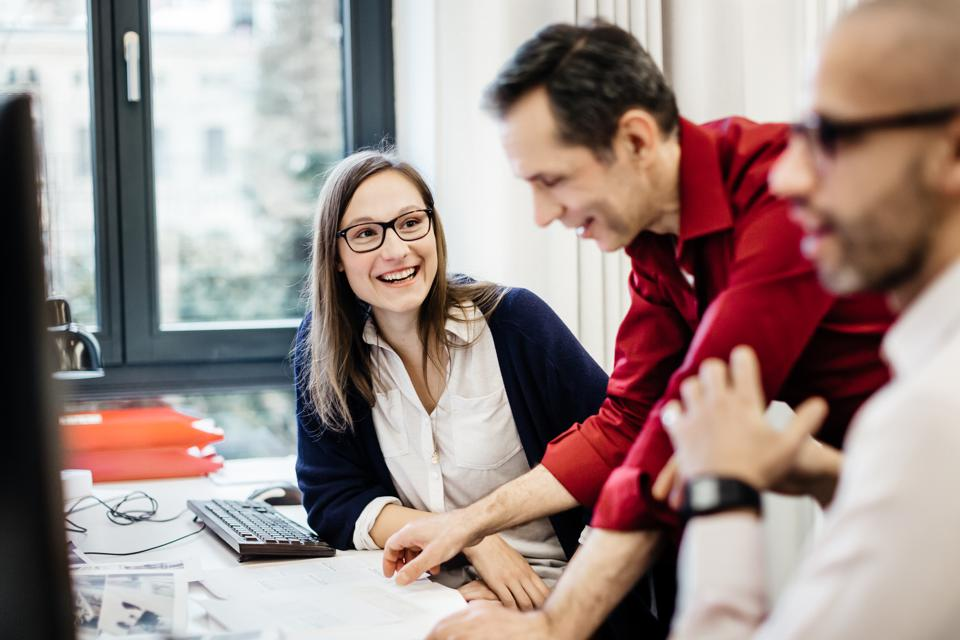 Businesswoman smiling at colleague in office
