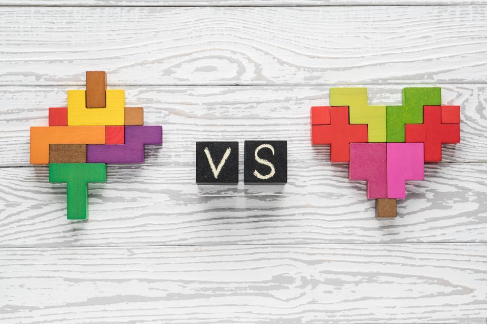 Heart vs Mind. Heart versus brain. Concept of mind against love.