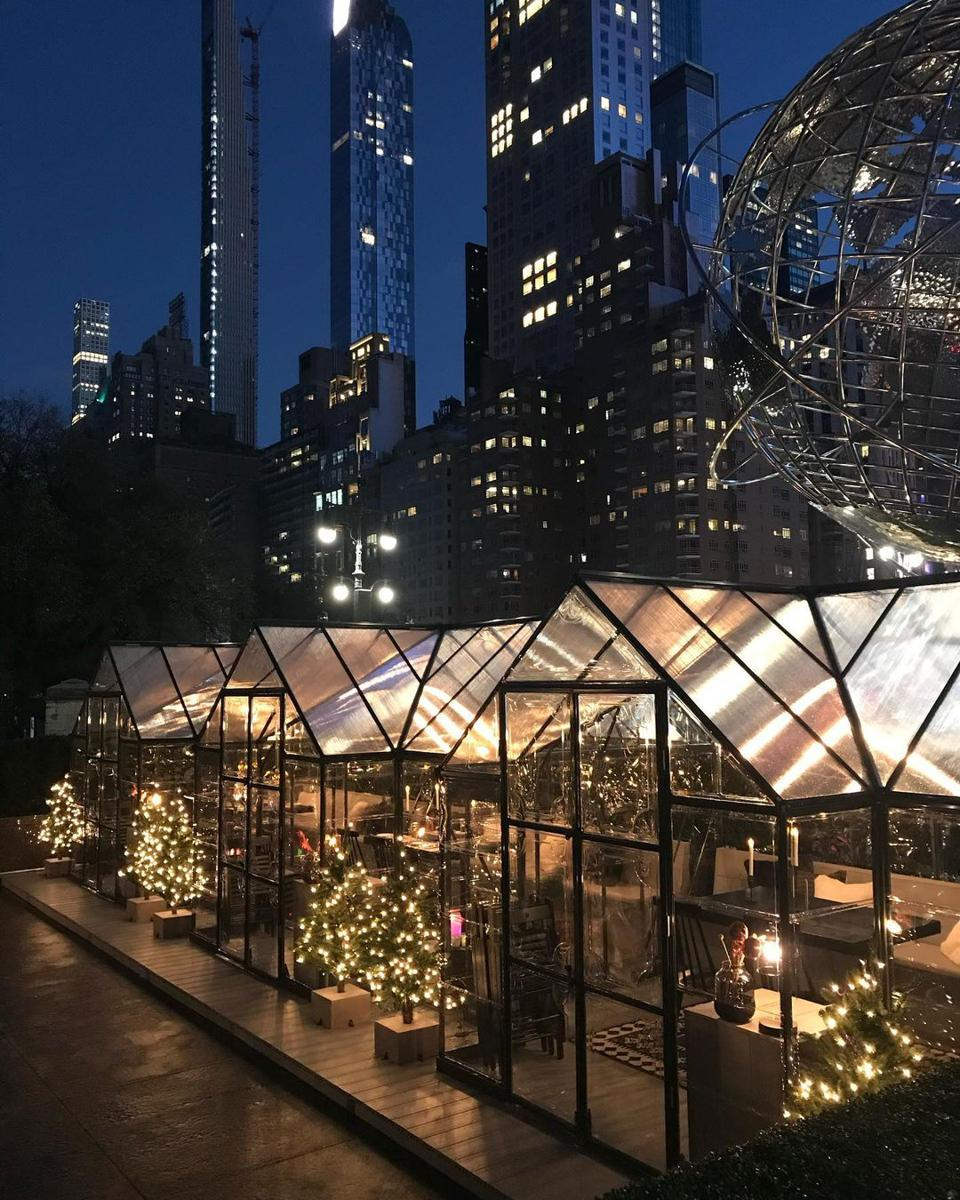 Luxurious greenhouses allow for outdoor dining that is cozy and romantic.