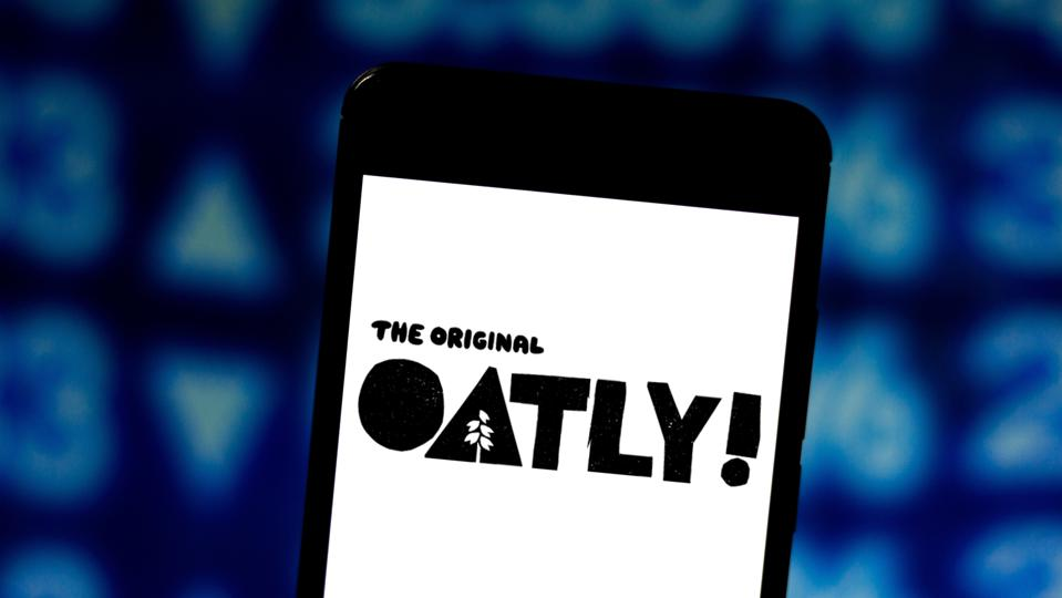 In this photo illustration the Oatly logo is seen displayed...