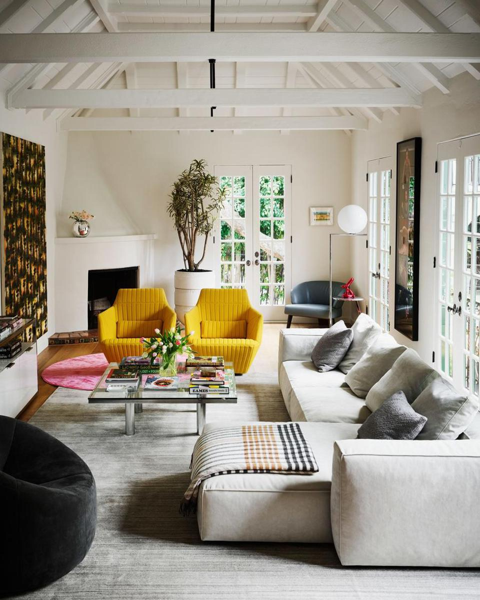 A beautiful living room with vaulted ceilings and bright pops of color.