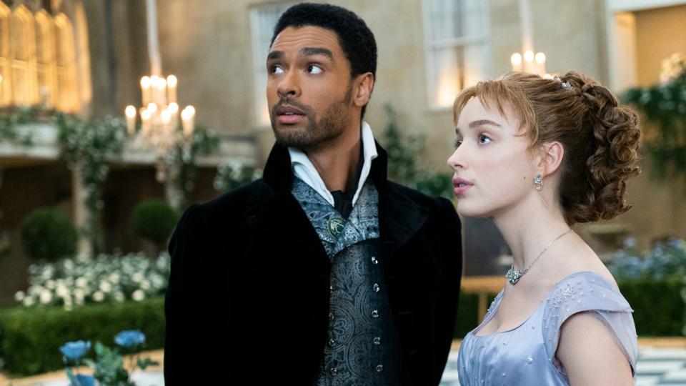 PHOEBE DYNEVOR as DAPHNE BRIDGERTON and REGÉ-JEAN PAGE as SIMON BASSET in BRIDGERTON