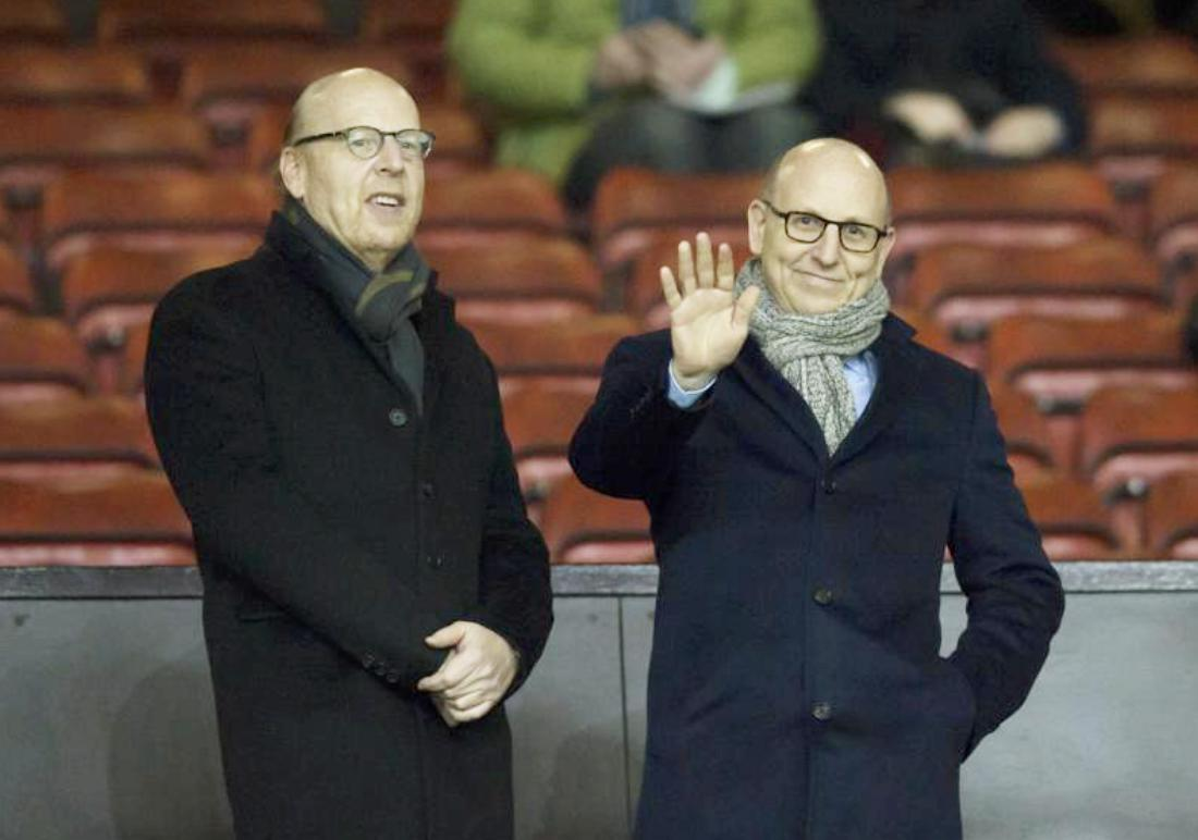 Avram, left, and Joel Glazer wait for play to begin before a Manchester United match in 2015.