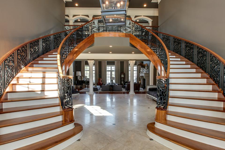 double staircase in mansion