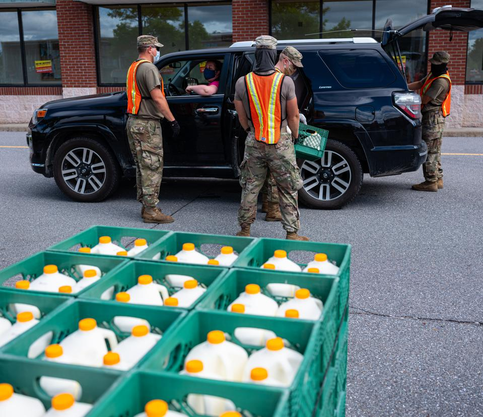 Members of the Vermont National Guard distribute food to needy families during Covid-19