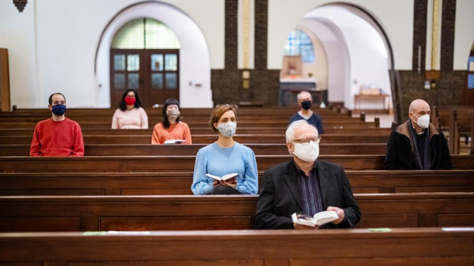 Group of people at church congregation during pandemic