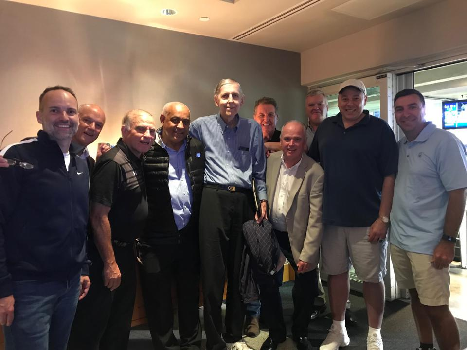 Tom Konchalski, middle, with former Mets GM Omar Minaya and friends at a Mets game.