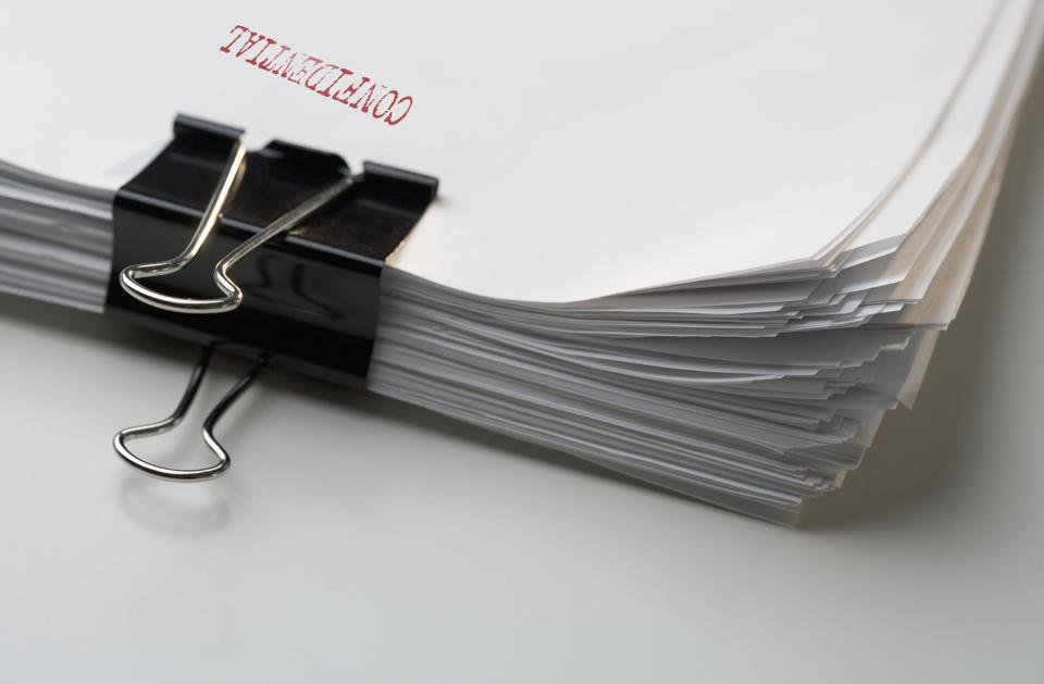 A stack of confidential papers