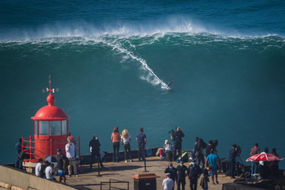 Big wave surfer Sebastian Steudtner from Germany rides a wave in winter in Nazare Portugal
