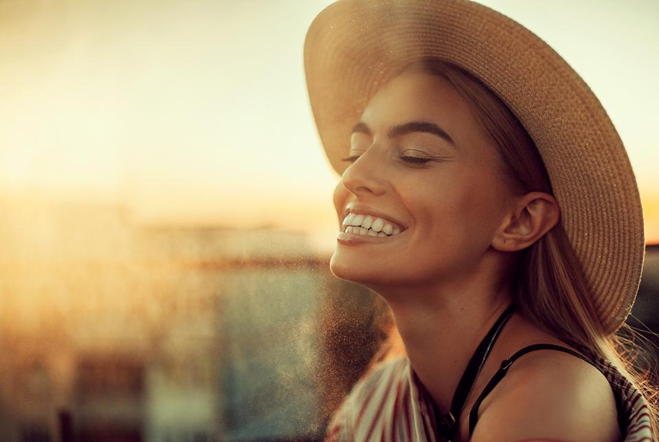 Portrait of young happy woman against of urban background.