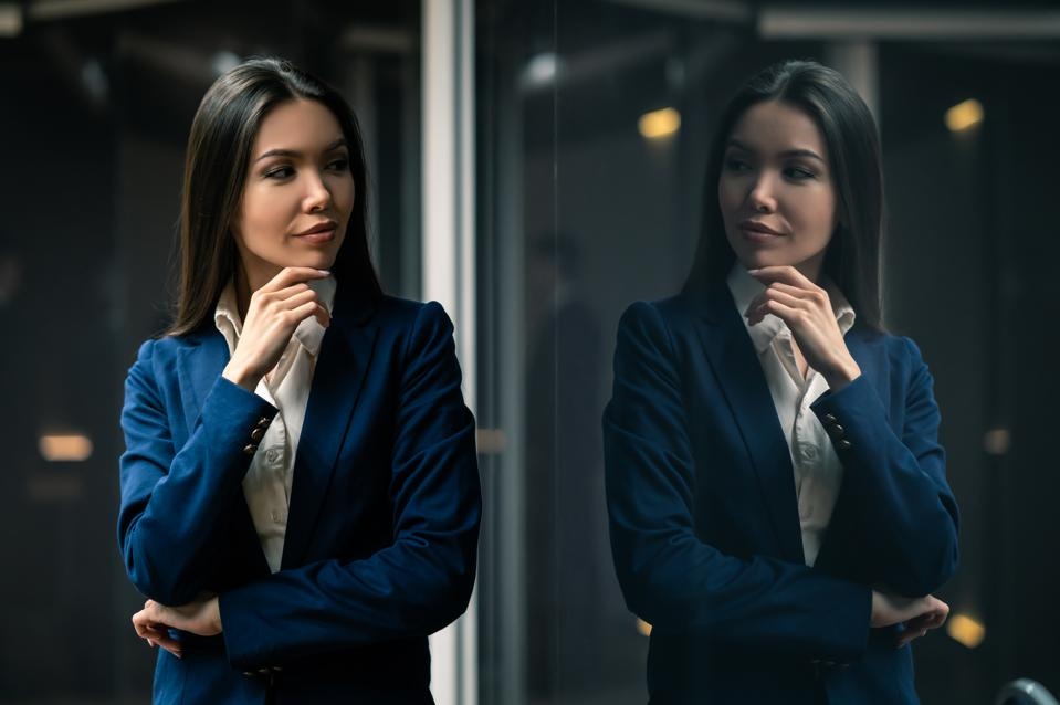 The young asian businesswoman standing indoor