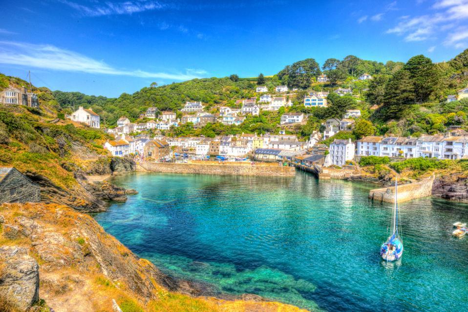 Polperro harbour Cornwall England UK with turquoise sea.