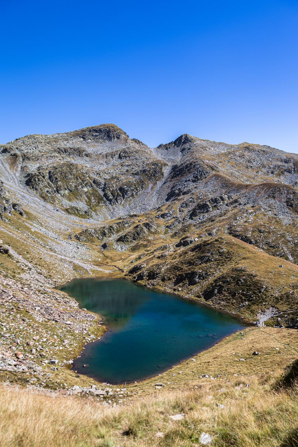 Stunning ariel view of the Lagh de Calvaresc lake with heart shape, in Swiss Alps,
