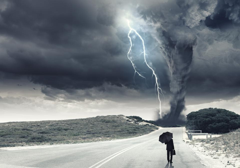 Picture of a person walking into a storm