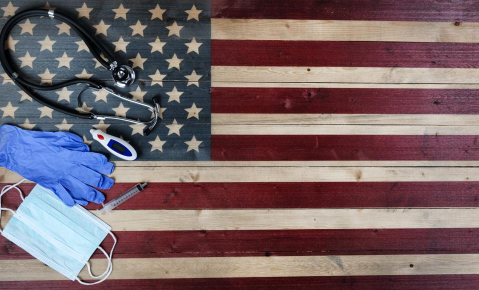 Directly Above Shot Of Medical Equipment On American Flag