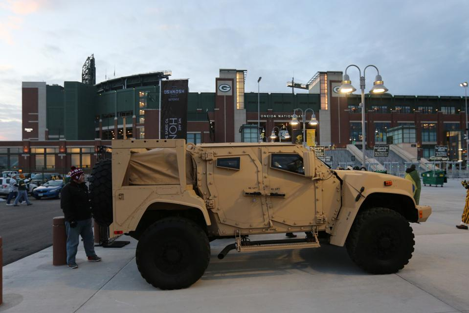 A JLTV at a Lions-Packers football game.